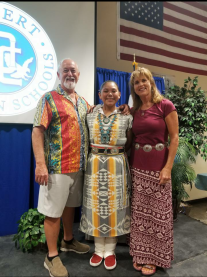 Denis and Lucy celebrate with Naomi (who chose to wear her traditional Native dress) her promotion from Desert Christian Middle School to Desert Christian High School